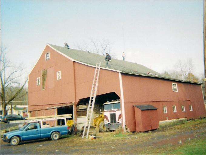 This picture shows the completed barn roof with new shingles.